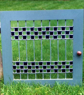 blue checkerboard stained glass with wood frame by Ann DeMuth