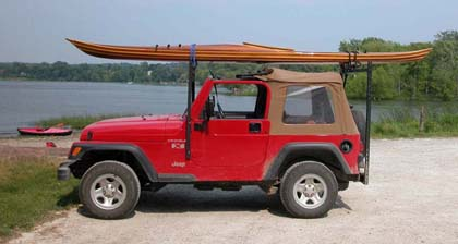 cedar strip kayak on Jeep by Ann DeMuth